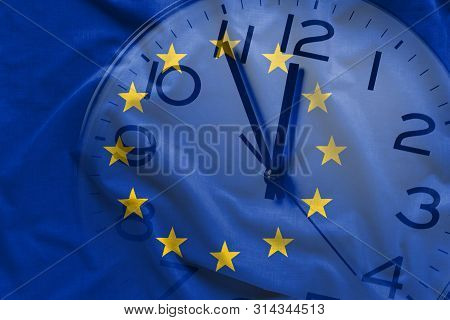 Double Exposure Of Clock And Blue Flag Of European Union