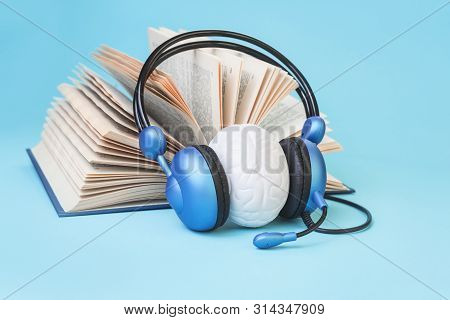 Open Book And Brain In Headphones On Blue. Listening Practice Or Test, Audio Books Dyslexia Reading