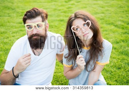Stay Focused With Best Goggles. Couple In Love Looking Through Prop Goggles On Green Grass. Sensual