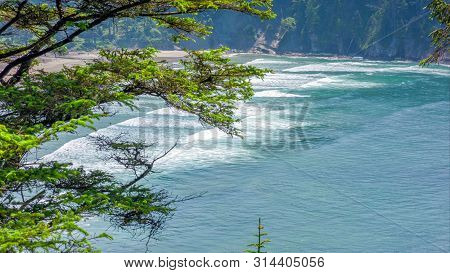 Pacific Northwest Coast, USA - the winding US route 101 along the misty Oregon coastline near Yachats. poster