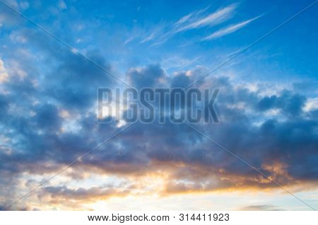 Sunset dramatic sky background - dramatic colorful clouds lit by sunlight. Vast sky landscape panoramic scene. Sunset sky landscape, sky clouds lit by sunset light, picturesque evening sky scene