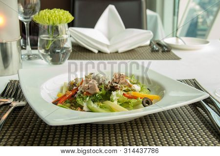 A Delicious Tuna Salad And Sauce On Plate