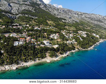 Dalmatia Drone View - Croatia Aerial Landscape Photo. Marusici And Mimice Town With Biokovo Mountain