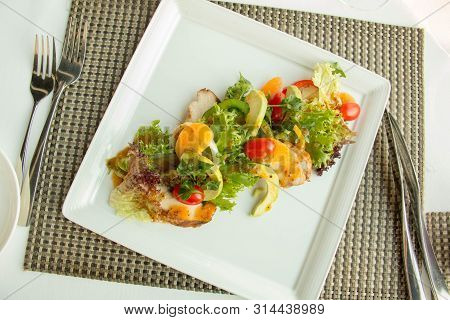 A Mixed Vegetables Salad In White Plate