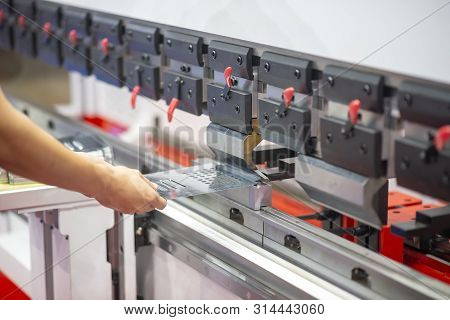 The Skill Operator Working With The Press Machine. The Sheet Metal Bending Process With The Hydrauli