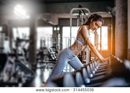 Young Sexy Girl In The Gym.attractive Fitness Woman, Trained Female Body, Lifestyle Portrait, Asian