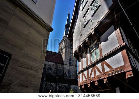 Upended Sugarloaf And St. Andreas Church In Hildesheim, Germany