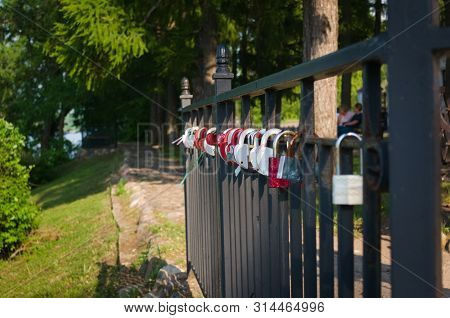 Bond Of Love. Lovers Proclaim Their Unbreakable Bond By Leaving Padlocks Fastened Onto A Fence