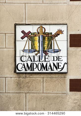 Madrid,spain-september 13, 2017: Street Sign Calle De Campomanes On A Hause Wall In Madrid, Spain
