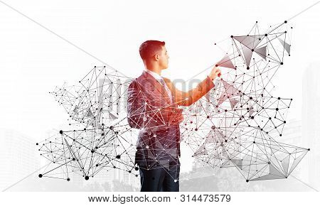 Business Person Pointing On Abstract Network Structure. Standing Personal Assistant In Business Suit