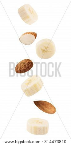 Floating Isolated On White Background Banana Fruits And Almonds