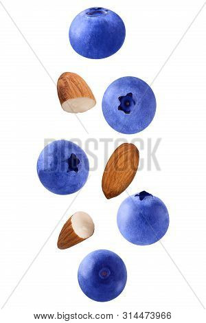 Floating Isolated On White Background Blueberry Fruits And Almonds