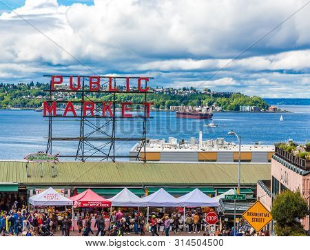 Seattle, Washington - May 13, 2017: Pike Place Market Is A Public Market Overlooking The Elliott Bay