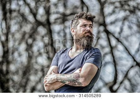 Man Attractive Bearded Hipster Posing Outdoors. Confident Posture Of Handsome Man. Guy Masculine App