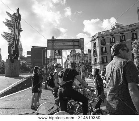 Barcelona, Spain - Jun 1, 2018: Pedestrians Men And Women Cyclists Waiting To Cross The Busy Pas Sot