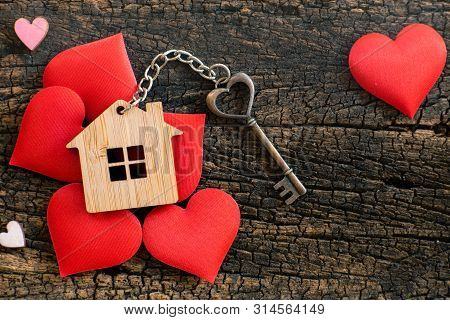 House Key In Heart Shape With Home Keyring On Old Wood Background Decorated With Mini Heart, Home Sw