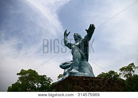 Nagasaki, Japan - 25 May 2013, Peace Park With Peace Statue. The Statue Is Commemorating The Atomic