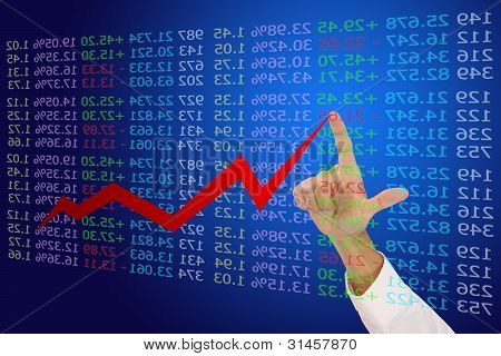 Business hand point to top of financial graph.