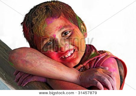 Close Up Face Of Young Boy Playing Holi, Smiling Colors, White Background