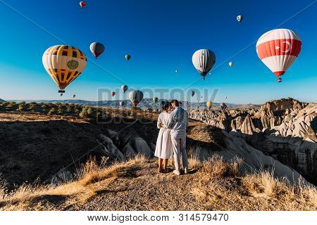 Couple Travels The World. Honeymoon Trip. Married Couple On Vacation. Tourists In Cappadocia. Man An