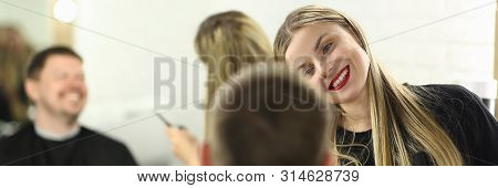 Smiling Hairstylist Making Haircut for Male Client. Woman Barber Styling Hairdo for Man in Barbershop. Hairdresser with Hairbrush in Hand Doing Hairstyle for Salon Customer. Person in Beauty Studio poster