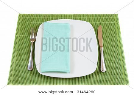 White Empty Dinner Plate With Napkin, Fork And Knife