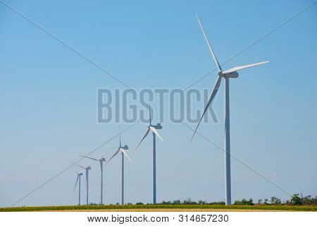 Wind Generator Turbines on the Clear Blue Sky Bacground. Green Renewable Energy Concept.