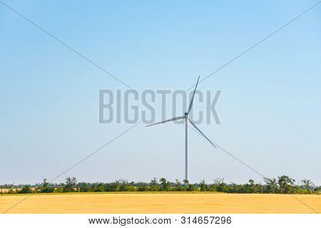 Wind Generator Turbine in the Field. Green Renewable Energy Concept.