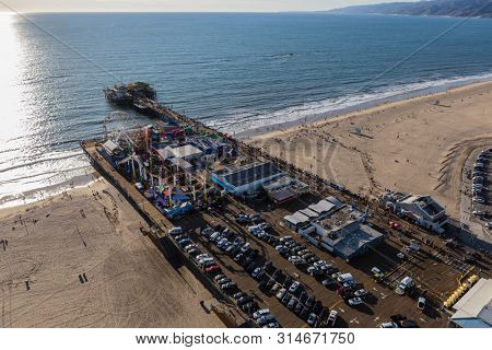 Santa Monica, California, USA - December 17, 2016:  Afternoon aerial view of famous Santa Monica Pier and beach on the Los Angeles County coast.