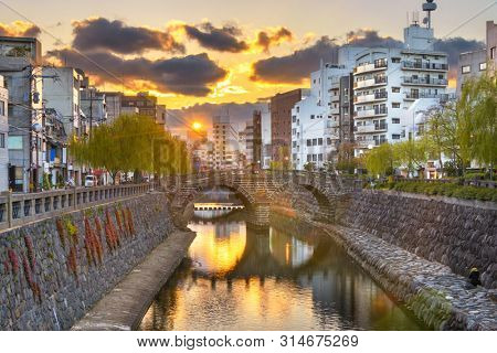 Nagasaki, Japan cityscape with Megane Spectacles Bridge at sunset.
