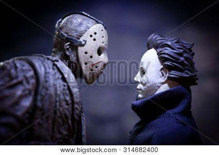 JULY 30 2019: Friday the 13th slasher Jason Voorhees and Halloween Michael Myers - NECA Ultimate Jason action figure - custom Myers figure using Funko Savage head