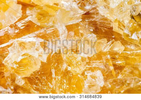 Closeup Of Yellow Honey Calcite Mineral Stone, Pattern Background With Details Of Mineralogy