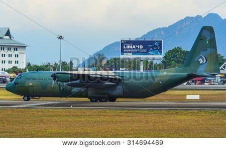 Langkawi, Malaysia - Mar 30, 2019. Lockheed C-130h Hercules Royal Malaysian Air Force (reg. Tudm M30