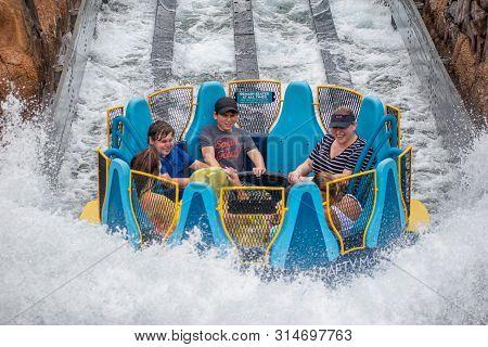 Orlando, Florida. July 13, 2019. People Having Fun Splashing In Infinity Falls At Seaworld 11