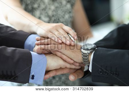 Focus On Hands Of Businesspeople In Suit Performing Team Spirit Hyping Movement To Highly Increase M