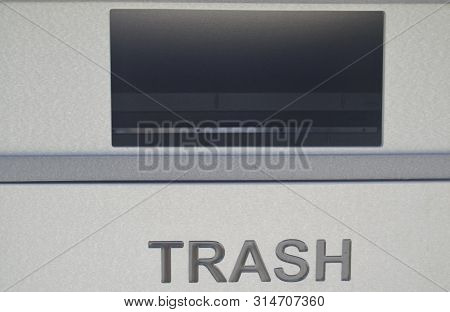 Open Slot On Gray Trash Can Receptacle