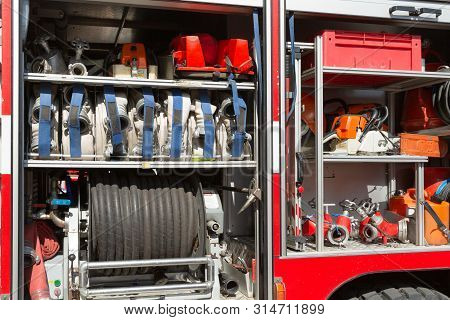 Part Of Equipment Of A Firetruck: Hoses And Syringe Of A Water Cannon