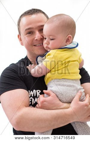 portrait of happy young father holding newborn baby boy isolated on a white background