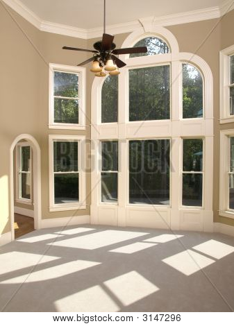 Luxury Model Home Living Room Arched Window Wall