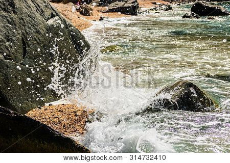 Water Splashing On The Rocks Of The Famous Shell Beach, In St. Barth's Island (st. Bart's Island) Ca