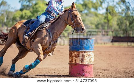 Close Up Of Competitor On Horseback Making A Figure Eight Turn In A Barrel Race At Outback Country R