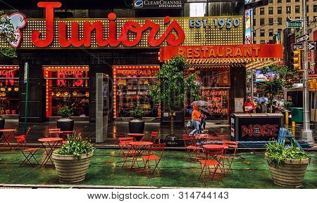 New York City, Usa, May 2019, View Of The Junior`s Restaurant Facade On Broadway On A Rainy Day