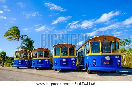 Grand Cayman, Cayman Islands, Jan 2019, Blue Trolley Buses From The Marineland Tours Company Parked
