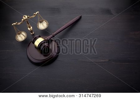 Judges Gavel And Scale Of Justice On The Black Table Background. Law Concept.