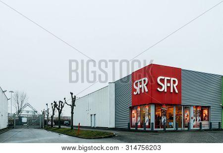 Paris, France - Feb 4, 2019: Street View Of Sfr Societe Francaise Du Radiotelephone Shop Offering Mu