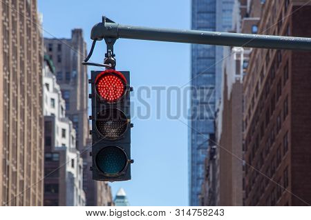 Traffic Light Closeup With Red Signal. Traffic Light On The Background Of Skyscrapers In New York. R