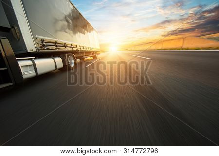 Detail of european truck vehicle on motorway. Cargo transportation and supply theme.