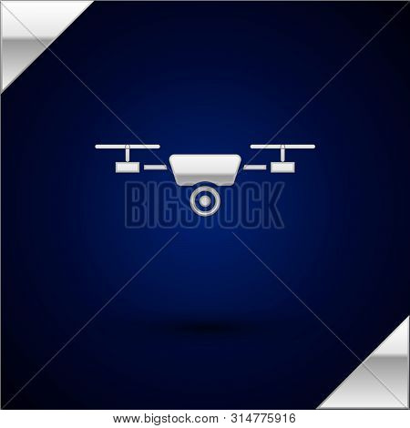 Silver Drone Flying With Action Video Camera Icon Isolated On Dark Blue Background. Quadrocopter Wit
