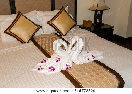 Beautiful Hotel For Honeymoon Sweet.swan Couple Put On Honeymoon Bed In A Hotel In Vietnam.