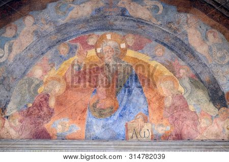 FLORENCE, ITALY - JANUARY 09, 2019: The Eternal Father and the Holy Innocents Martyrs, frescoed lunette by Giovanni di Francesco, Ospedale degli Innocenti - Exterior arcade, Florence, Italy